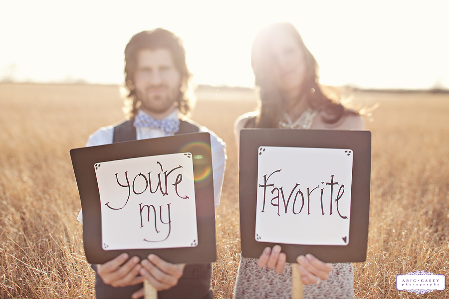 you're my favorite signs in a sweet, lovely simple engagement pictures in a field by aric and casey