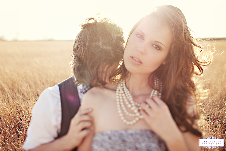 sweet, lovely sexy and romantic simple engagement pictures in a field by aric and casey