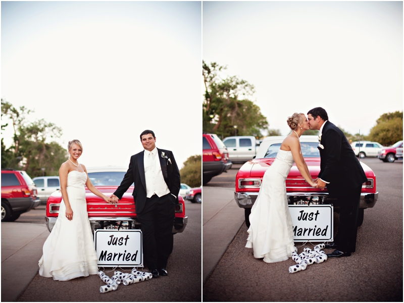 Just Married sign on old Chevrolet with bride and groom
