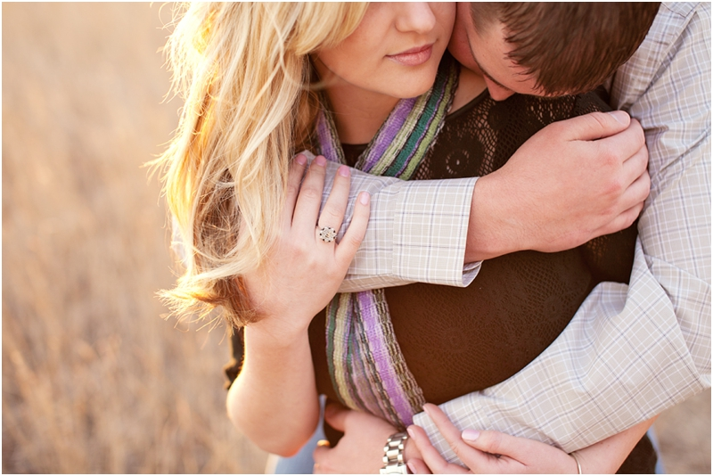 holding on tight engagement picture in a field