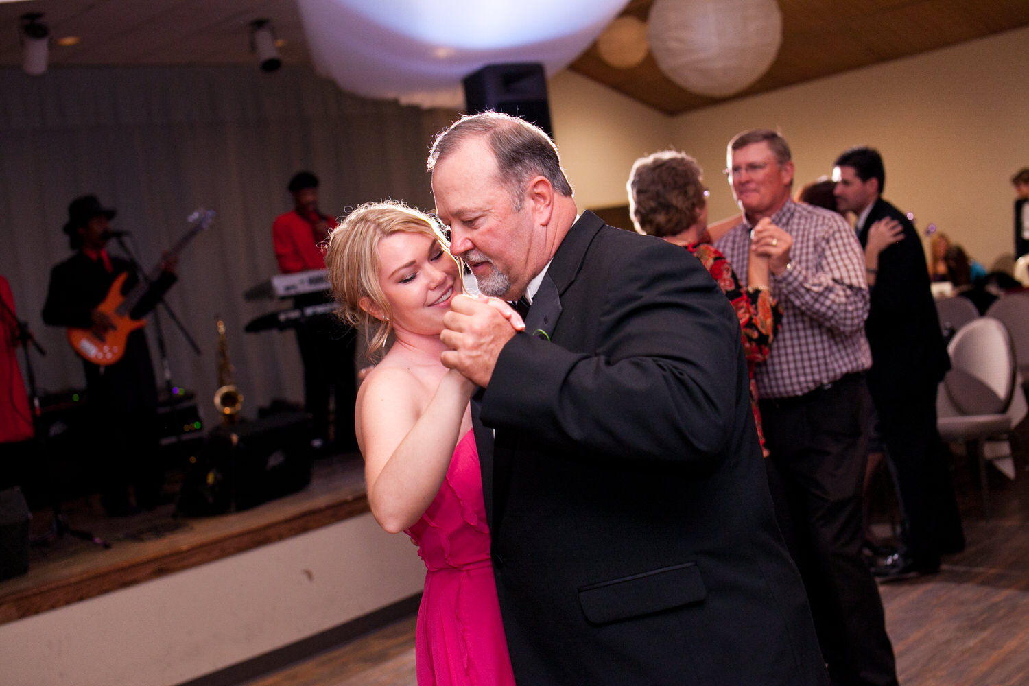 father and sister dancing