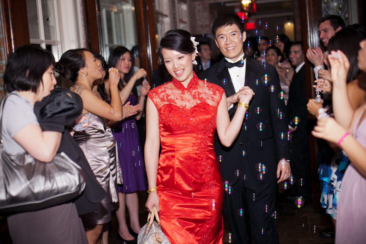 bride and groom exit rice wedding